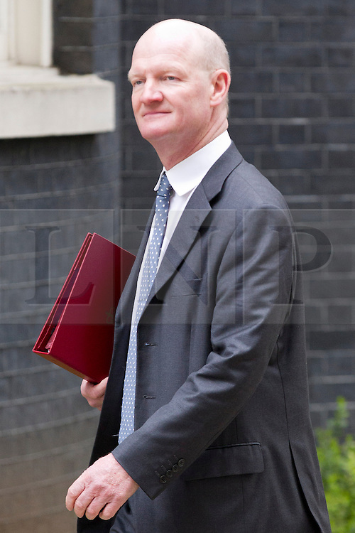 © Licensed to London News Pictures. 18/03/2014. London, UK. The Minister for Universities and Science, David Willetts, arrives for a meeting of the British cabinet on Downing Street in London today (18/03/2014). Photo credit: Matt Cetti-Roberts/LNP