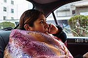 """Maria Eugenia Mamani Herrera, alias """"Claudina the Cursed"""", dressed like Cholita, calls by phone while goes to the Community Center El Alto to participate in a wrestling show in La Paz, Bolivia, February 26, 2012."""