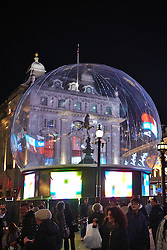 © Licensed to London News Pictures.  15/11/2013. LONDON, UK. A 30 foot plastic snow globe has been installed over the Eros statue in Piccadilly Circus. When completed fans will blow fake snowflakes around inside. Photo credit: Cliff Hide/LNP