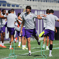 Kaka (10)  stretches his legs during the Orlando City Soccer club MLS practice at the Florida Citrus Bowl on Wednesday, March 4, 2015 in Orlando ,Florida. The first season for the Lions is scheduled to begin on March 8, and over 60,000 tickets have been sold for the home opener, though a league wide player strike may occur prior to the beginning of the scheduled season. (AP Photo/Alex Menendez)