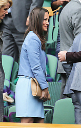 Pippa Middleton leaves the Royal Box on Centre Court on the opening day of Wimbledon 2013<br /> London, Monday, 24th June 2013<br /> Picture by Stephen Lock / i-Images