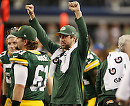 Green Bay Packers quarterback Aaron Rodgers (12) celebrates their victory after the Green Bay Packers defeated the Dallas Cowboys  NFL game in Dallas, Texas Sunday, December, 15, 2013. (AP Photo/Tom Hauck)