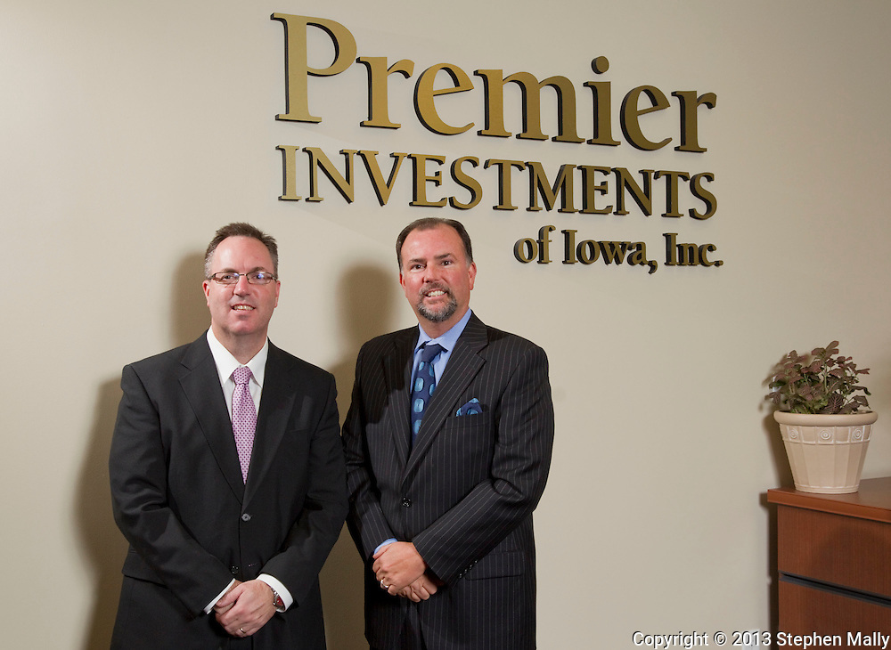 Brock Renner and Jeffrey Johnston (from left) at Premier Investments of Iowa, Inc. in Cedar Rapids on Friday, November 16, 2012.