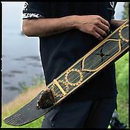 """Ainu guide holds his """"tonkori"""", a traditional Ainu musical instrument, Shiretoko Peninsula, Hokkaido, Japan."""
