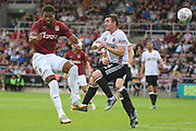 Northampton Town forward Vadaine Oliver (10) heads the ball  under pressure from Sheffield United midfielder John Fleck (4) during the Pre-Season Friendly match between Northampton Town and Sheffield United at the PTS Academy Stadium, Northampton, England on 20 July 2019.