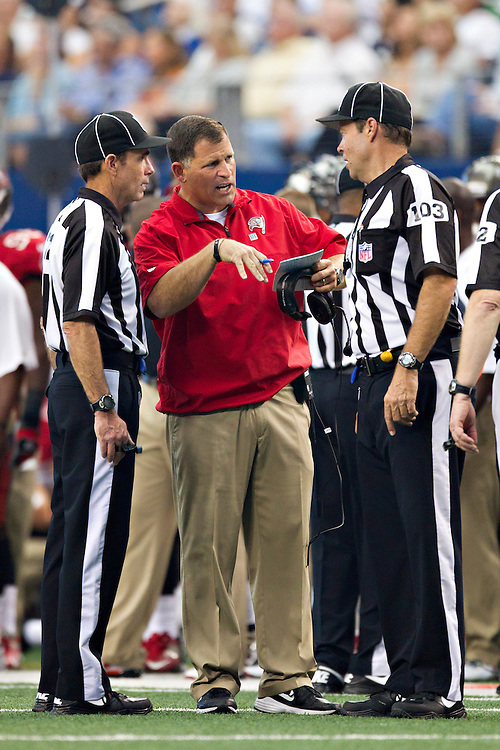 DALLAS, TX - SEPTEMBER 23:  Head Coach Greg Schiano of the Tampa Bay Buccaneers talks with officials during a game against the Dallas Cowboys at Cowboys Stadium on September 23, 2012 in Dallas, Texas.  The Cowboys defeated the Buccaneers 16-10.  (Photo by Wesley Hitt/Getty Images) *** Local Caption *** Greg Schiano