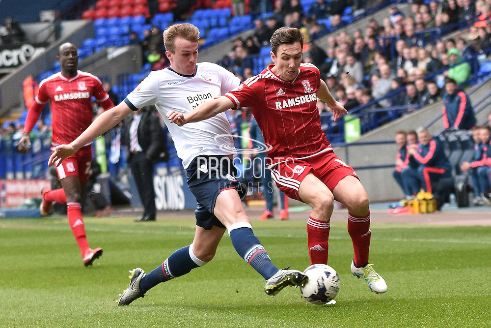 Middlesbrough Midfielder, Stewart Downing is tackledduring the Sky Bet Championship match between Bolton Wanderers and Middlesbrough at the Macron Stadium, Bolton, England on 16 April 2016. Photo by Mark Pollitt.