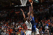 January 15, 2018: Marvin Bagley III #35 of Duke shoots over Dewan Huell #20 of Miami during the NCAA basketball game between the Miami Hurricanes and the Duke Blue Devils in Coral Gables, Florida. The Blue Devils defeated the 'Canes 83-75.