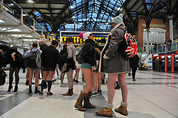 © Licensed to London News Pictures. 07/01/2018 London, UK. People take part in 'International No Pants Subway Ride Day', called 'no trousers on the tube day' in London. Organised by The Stiff Upper Lip Society and Improv Everywhere the event saw the London Underground hijacked by scores of half clad passengers.<br /> Photo credit: Guilhem Baker/LNP