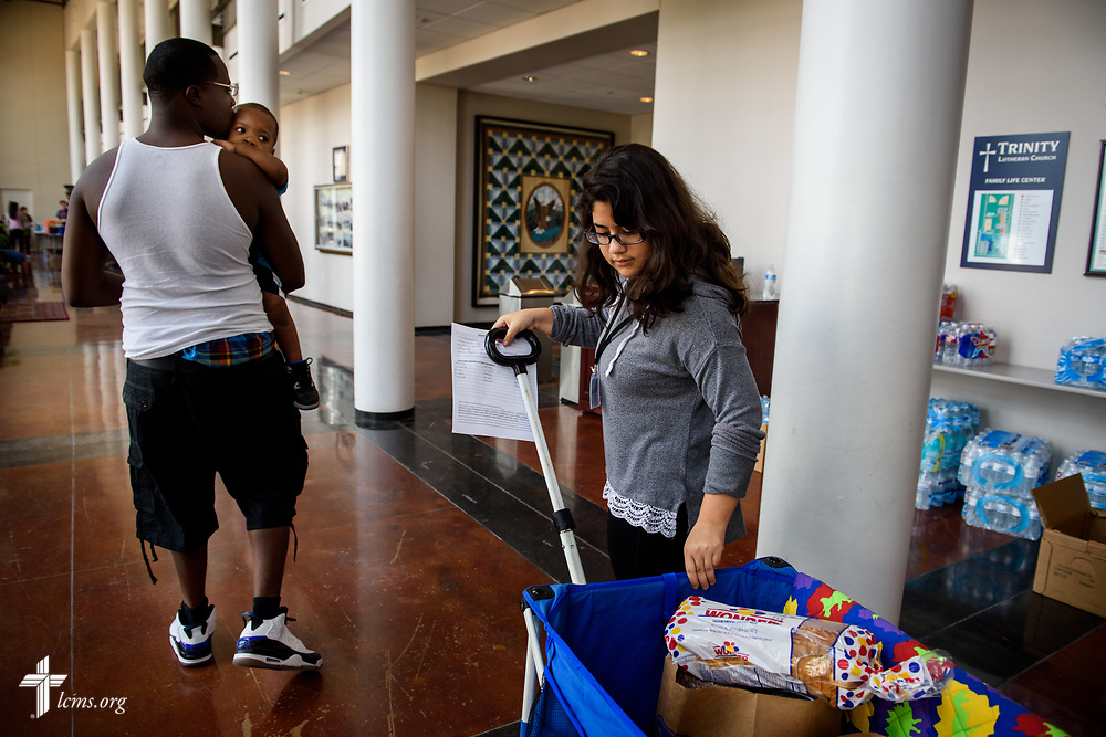A volunteer from Trinity Klein Lutheran Church, Spring, Texas, hauls donated supplies for Hurricane Harvey victims at the church on Saturday, Sept. 2, 2017. LCMS Communications/Erik M. Lunsford