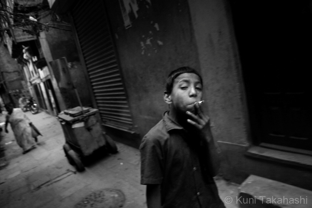 A street child smoke cigarette in Kathmandu, Nepal, on May 2010.<br /> Photo by Kuni Takahashi