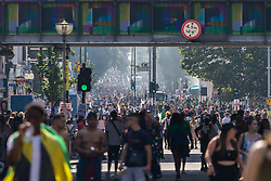 Thousands throng Ladbroke Grove as day one, Children's Day, of the Notting Hill Carnival gets underway in London. London, August 25 2019.
