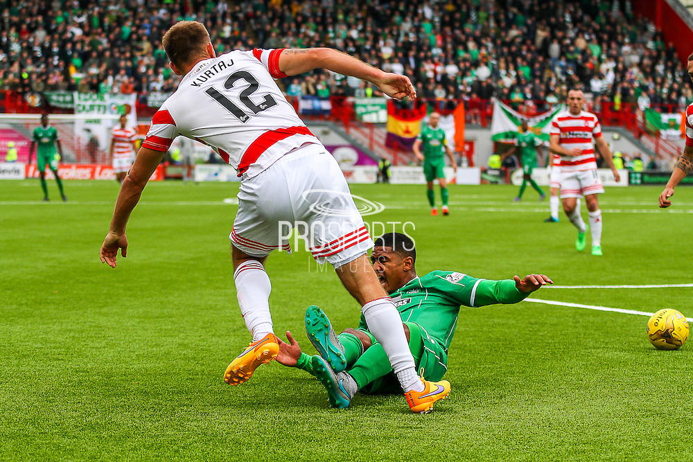 Celtic FC Defender Saidy Janko on the ground after Hamilton Academical Midfielder Gramoz Kurtaj challenge during the Ladbrokes Scottish Premiership match between Hamilton Academical FC and Celtic at New Douglas Park, Hamilton, Scotland on 4 October 2015. Photo by Craig McAllister.