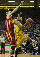 December 09 2010: Iowa guard Kachine Alexander (21) puts up a shot by Iowa St. center Anna Prins (55) during the first half of their NCAA basketball game at Carver-Hawkeye Arena in Iowa City, Iowa on December 9, 2010. Iowa defeated Iowa State 62-40 in the Hy-Vee Cy-Hawk Series rivalry game.