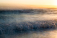 Moody ocean blurs at sunset, Buffalo Bay, Western Cape, South Africa