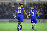 AFC Wimbledon striker Lyle Taylor (33) slaps AFC Wimbledon defender Barry Fuller (2) hand during the EFL Sky Bet League 1 match between AFC Wimbledon and Gillingham at the Cherry Red Records Stadium, Kingston, England on 12 September 2017. Photo by Matthew Redman.