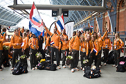 © Licensed to London News Pictures. 13/08/2012. London,UK. Dutch Olympic Team waving their national flag on the platform  at St. Pancras International as they leave the UK to head home following the 2012 Olympic games. Photo credit : Thomas Campean/LNP