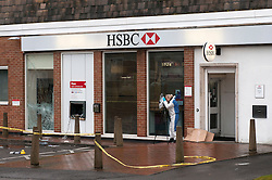© Licensed to London News Pictures. 13/10/2014. Bristol, UK. Police forensics staff at scene of cashpoint robbery at the HSBC branch on Bath Road, Brislington.  Thieves used gas canisters to blow up the cash machine. Photo credit : Simon Chapman/LNP