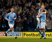 Photo. Jed Wee. Digitalsport<br /> Manchester City v Norwich City, Barclays Premiership, 01/11/2004.<br /> Manchester City's Willo Flood celebrates his goal on the shoulders of Paul Bosvelt, as Antoine Sibierski joins the celebrations