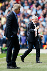 Stoke Manager Mark Hughes celebrates after Mame Biram Diouf of Stoke scores a goal to give his side a 0-1 lead - Photo mandatory by-line: Rogan Thomson/JMP - 07966 386802 - 30/08/2014 - SPORT - FOOTBALL - Manchester, England - Etihad Stadium - Manchester City v Stoke City - Barclays Premier League.