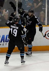 May 8, 2011; San Jose, CA, USA; San Jose Sharks right wing Devin Setoguchi (16) is congratulated by center Joe Thornton (19) after scoring a goal against the Detroit Red Wings during the first period of game five of the western conference semifinals of the 2011 Stanley Cup playoffs at HP Pavilion. Mandatory Credit: Jason O. Watson / US PRESSWIRE