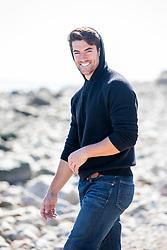 hot guy enjoying a walk at the beach