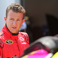 NASCAR Sprint Cup driver AJ Allmendinger is seen in the garage area during the NASCAR Coke Zero 400 Sprint practice session at the Daytona International Speedway on Thursday, July 4, 2013 in Daytona Beach, Florida.  (AP Photo/Alex Menendez)