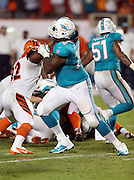 Miami Dolphins tackle Bryant McKinnie (78) blocks during the NFL week 9 football game against the Cincinnati Bengals on Thursday, Oct. 31, 2013 in Miami Gardens, Fla.. The Dolphins won the game 22-20 in overtime. ©Paul Anthony Spinelli