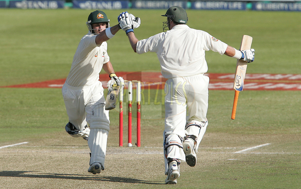 Phillip Hughes (left) celebrates his century (100, ton) with Mike Hussey.  Phillip Hughes is the youngest ever person to score a century in both innings of a test match during day 3 of the 2nd Castle Test between South Africa and Australia held at Kingsmead Sahara park Stadium in Durban, South Africa on the 8 March 2009..Photo by: SPORTZPICS