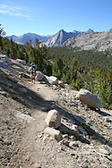 Hiker heads southbound along the John Muir Trail, King's Canyon National Park