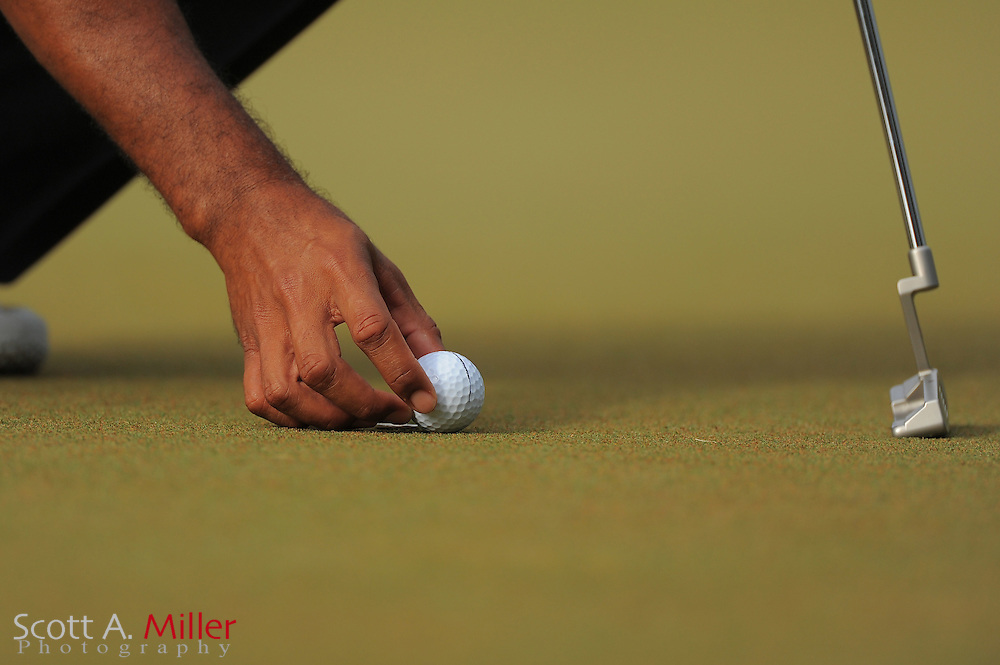 Detail of Tiger Woods hand as he places his ball for a putt during the first round of the Players Championship at the TPC Sawgrass on May 10, 2012 in Ponte Vedra, Fla. ..©2012 Scott A. Miller..