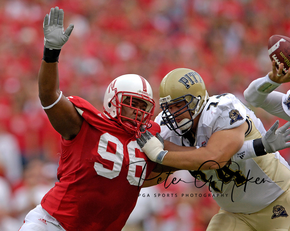 Nebraska defensive tackle Titus Adams (96) rushes to the Pitt quarterback against Pitt offensive tackle Dale Williams (74), during the first quarter of the Huskers 7-6 win at Memorial Stadium in Lincoln, Nebraska on September 17, 2005.