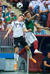 MOSCOW, RUSSIA - Sunday, June 17, 2018: Germany's Julian Draxler (left) and Mexico's Carlos Salcedo (right) during the FIFA World Cup Russia 2018 Group F match between Germany and Mexico at the Luzhniki Stadium. (Pic by David Rawcliffe/Propaganda)