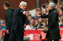 Stoke City manager Mark Hughes argues with Manchester United manager Jose Mourinho in the technical area - Mandatory by-line: Matt McNulty/JMP - 09/09/2017 - FOOTBALL - Bet365 Stadium - Stoke-on-Trent, England - Stoke City v Manchester United - Premier League