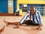 Jean Paul Ngilimana is warming up to play sitting volley ball. He is a member of the National Paralympic Committee (NPC). NPC works with disabled people and sport throughout Rwanda, from grass roots to international level, using sport as a means of social integration.