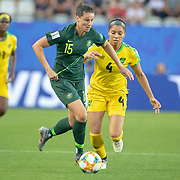 GRENOBLE, FRANCE June 18.  Emily Gielnik #15 of Australia defended by Chantelle Swaby #4 of Jamaica during the Jamaica V Australia, Group C match at the FIFA Women's World Cup at Stade des Alpes on June 18th 2019 in Grenoble, France. (Photo by Tim Clayton/Corbis via Getty Images)