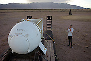 "Evan Menzel at Site Trinity, ground zero, on the White Sands Missile Range in S. New Mexico. Site of the world's first atomic explosiion on August 6, 1945. The atomic bomb was developed by the Manhatten Project. The Manhattan Project refers to the effort during World War II by the United States, in collaboration with the United Kingdom, Canada, and other European physicists, to develop the first nuclear weapons. Formally designated as the Manhattan Engineering District (MED), it refers specifically to the period of the project from 1942-1946 under the control of the U.S. Army Corps of Engineers, under the administration of General Leslie R. Groves, with its scientific research directed by the American physicist J. Robert Oppenheimer. The project succeeded in developing and detonating three nuclear weapons in 1945: a test detonation on July 16 (the Trinity test) near Alamogordo, New Mexico; an enriched uranium bomb code-named ""Little Boy"" detonated on August 6 over Hiroshima, Japan; and a plutonium bomb code-named ""Fat Man"" on August 9 over Nagasaki, Japan. (http://en.wikipedia.org/wiki/Manhattan_Project) MODEL RELEASED."