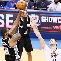 06 May 2016: San Antonio Spurs forward LaMarcus Aldridge (12) takes a jump shot over Oklahoma City Thunder center Enes Kanter (11) during the San Antonio Spurs 100-96 victory over the Oklahoma City Thunder, during Game Three of the Western Conference Semifinals of the NBA Playoffs at the Chesapeake Energy Arena, Oklahoma City, Oklahoma, USA.
