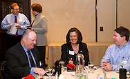 Brian Gompers of South Financial Group (left) talks with Susan Phillips of Congressman Steve Austria's office while (from left) Chris Hutchinson of Harrison College, Pam Strickler of Congressman Austria's office and Rodney Willis of CHW Mechanical Services talk at a table during the Dayton Area Chamber of Commerce Breakfast Briefing featuring Wright State University president David Hopkins at the Dayton Racquet Club in downtown Dayton, Friday, December 9, 2011.