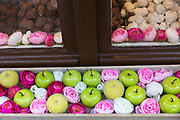 Shop window display of flowers and apples in Bruges, Belgium