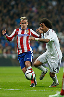 Real Madrid´s Marcelo Vieira (R) and Atletico de Madrid´s Griezmann during Spanish King´s Cup match at Santiago Bernabeu stadium in Madrid, Spain. January 15, 2015. (ALTERPHOTOS/Victor Blanco)