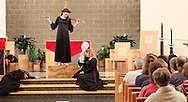 Jubilee members interpret Station Twelve, where Jesus dies on the cross, during a performance of 'The Way of the Cross' at St. Luke Catholic Parish in Beavercreek, Friday, March 30, 2012.  'The Way of the Cross' retraces 'the path Jesus walked on his way to Calvary.'