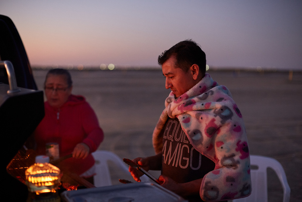 Grilling dinner at East Beach on Galveston Island. Photographed Wednesday evening February 22, 2017 for Texas Highways Magazine.<br /> <br /> Nathan Lindstrom for Texas Highways<br /> <br /> ©2017 Nathan Lindstrom