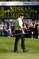 18 February 2007: Phil Mickelson walks on the green with the logo on the digital leader board  during the final day of the Nissan Open PGA golf tournament at the Riviera Country Club in Los Angeles, CA.