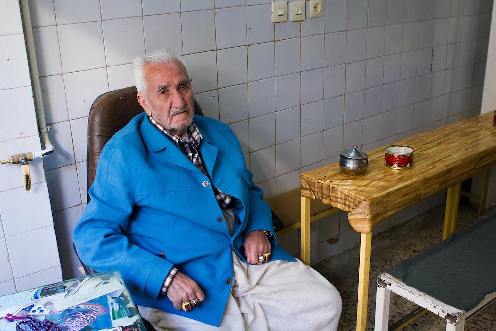 The Kurdish owner of a small tea shop in the old bazaar (Sanandaj, Iran, 2012).