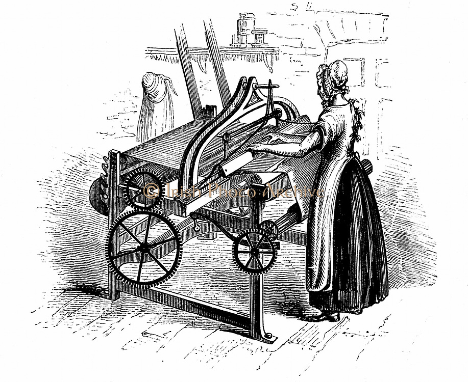 Power loom for weaving cotton. Model illustrated is that invented by Roberts (c1815-20). Belting connecting to drive shaft is shown at centre back of picture. Female operative. Wood engraving c1840.