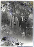 hunter with gun dog and adult man posing