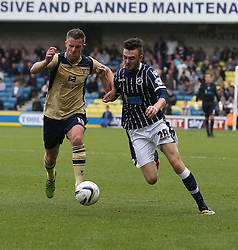 Leeds United's Luke Varney vies for possession with Millwall's Scott Malone - Photo mandatory by-line: Robin White/JMP - Tel: Mobile: 07966 386802 28/09/2013 - SPORT - FOOTBALL - The Den - Millwall - Millwall V Leeds United - Sky Bet Championship