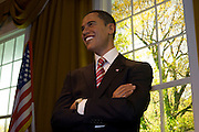 Standing in a recreation of the Oval Office, the waxwork figure of the 44th President of the United States, Barack Obama stands in London's Madame Tussauds waxwork museum on the day of his inauguration. Long before the actual election took place, models of both Obama and political opponent, John McCain were researched from thousands of photographs and 500 body measurements and prepared from clay, taking 20 dedicated sculptors 4 months to prepare. On the eventual victor was completed using wax and real organic hair. Only Obama's inauguration day, US citizens were allowed free entry to the museum which is now Britain's most visited tourist attraction.