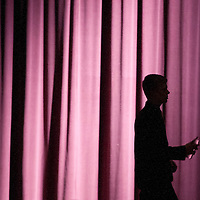 Daniel Wright walks acrosss the stage prior to the start of rehearsal for Grove City High's production of Sasquatch: The Musical.